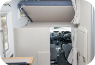 Explorer Interior: Overhead Bed Tilts For Easy Access To Cab